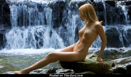 Naked blonde with medium natural tots & big nipples picture