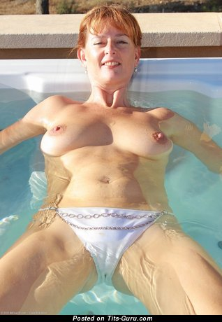 Delightful Red Hair with Amazing Naked Natural Boobs in the Pool (Private Porn Pix)