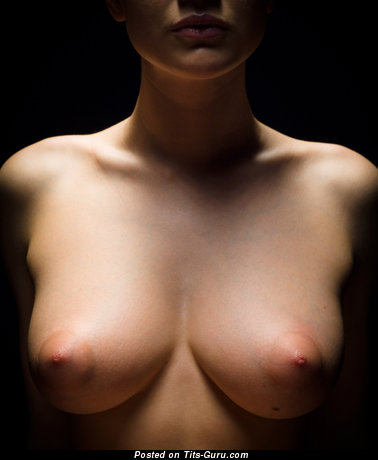 Image. Naked beautiful woman with medium natural boobies photo