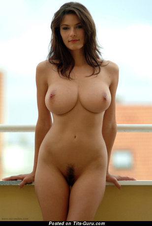 Image. Sexy topless brunette with medium natural boobs picture