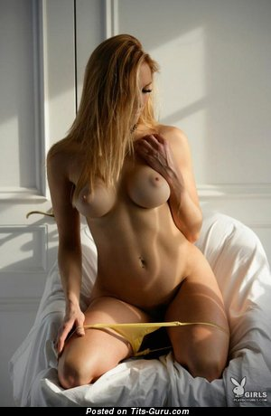 Image. Nude blonde with medium tits pic