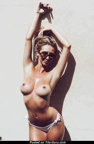 Image. Sexy topless amateur blonde with medium natural tits photo