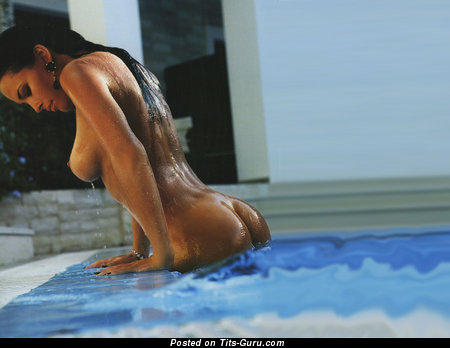 Dasha Astafieva - wet nude brunette with medium natural boobies pic