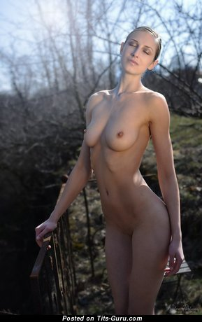 Nude beautiful girl with medium natural boobs picture