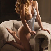 Nude nice lady with medium tots photo
