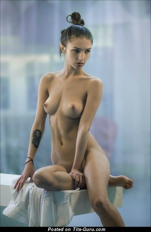 Image. Naked wonderful female with medium natural tittys photo