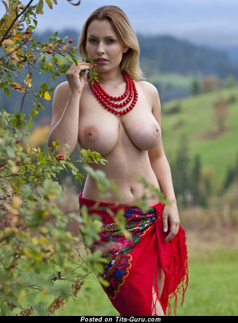 Sexy nude wonderful woman with medium natural tittes and big nipples photo