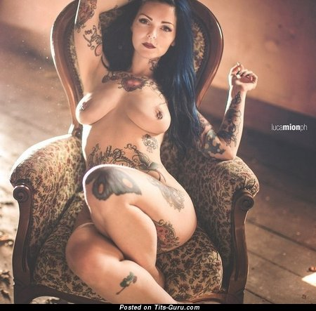 Image. Brunette with big natural boobies and tattoo image
