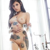 Amazing girl with medium boob and tattoo image