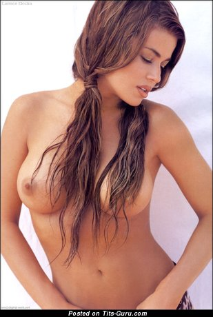 Carmen Electra - topless red hair with medium breast image