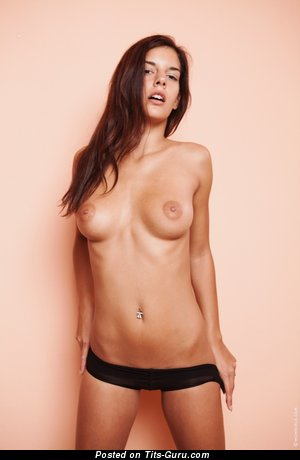 Image. Nude brunette with medium natural boobies and piercing picture
