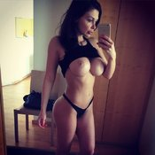 Topless brunette with big fake boobies selfie