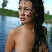 Wet brunette with medium natural boob picture