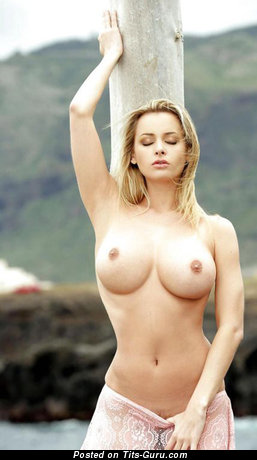 Image. Sexy topless blonde with medium breast pic