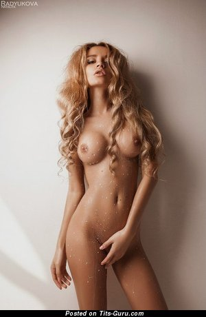 Image. Sexy wet topless blonde with medium fake tittys picture