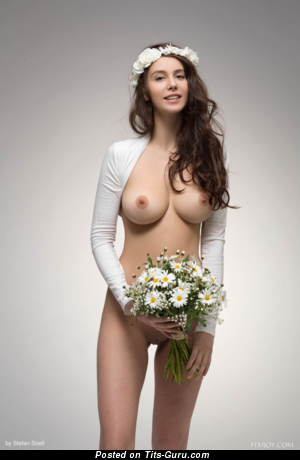 Naked brunette with medium natural tits photo