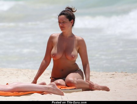 Kelly Brook - topless red hair with medium natural tits pic