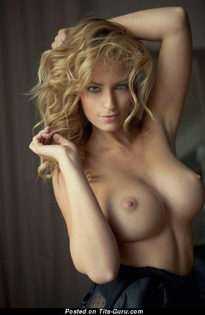 Sexy naked blonde with medium natural breast pic