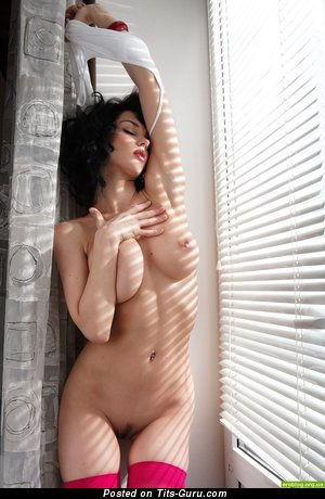 Image. Naked brunette with natural boobies photo