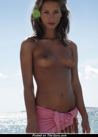 Image. Nude awesome female with medium natural tots pic