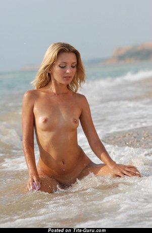 Image. Wet blonde with small natural tittes pic