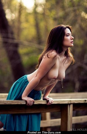 Image. Sexy topless brunette with medium natural boob photo