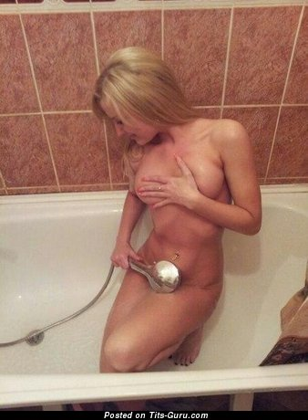 Image. Sexy topless amateur blonde with medium boob photo