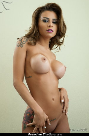 Image. Junia Cabral - naked latina blonde with big fake boobies and big nipples image