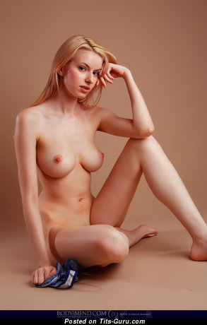 Image. Izolda Queen - nude hot lady with medium natural tittes image