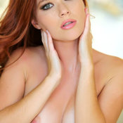 Sexy red hair with medium natural boob image