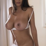 Fabiana Britto De Melo - topless latina brunette with medium natural tittes and big nipples photo
