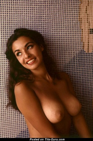Image. Unknown - brunette with natural breast pic