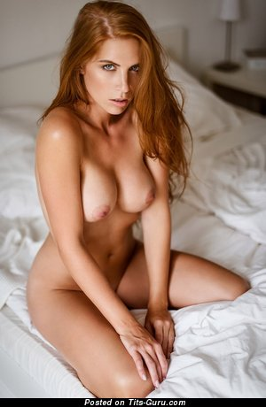 Image. Sexy topless amateur red hair with medium natural tittys photo
