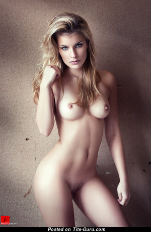 Image. Naked blonde with medium natural tittys photo