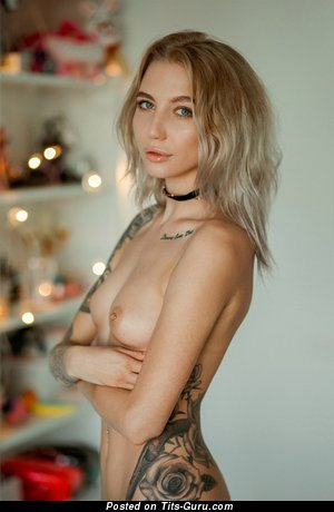 Image. Naked blonde with natural boobs, piercing and tattoo pic