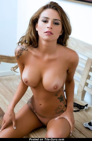Image. Junia Cabral - sexy naked brunette with medium natural breast and tattoo photo