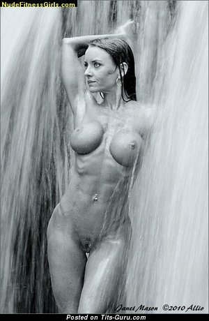 Image. Wet naked brunette with big fake breast and piercing photo