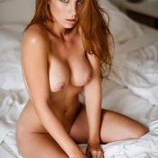 Sexy topless amateur red hair with medium natural boob picture