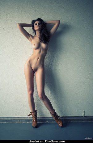 Sexy naked brunette with medium boobies picture