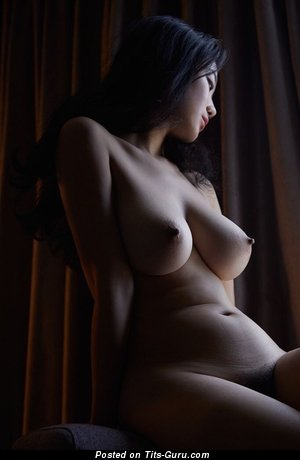 Sexy naked hot female with medium natural boobies picture
