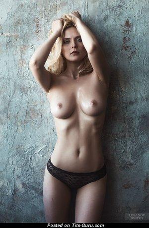 Image. Hot woman with medium natural tittes image