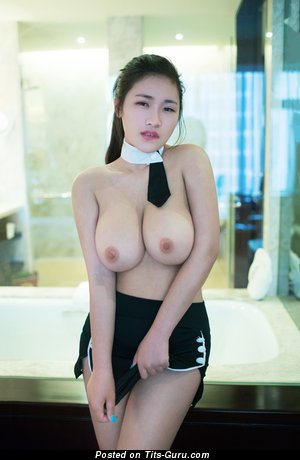 Lian Xin - nude asian with medium natural tittes photo