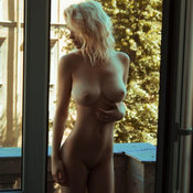 Sexy naked blonde with medium natural boobs photo