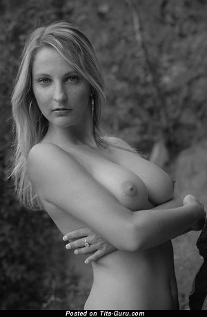 Iva - sexy topless amateur blonde with medium natural tits and big nipples photo