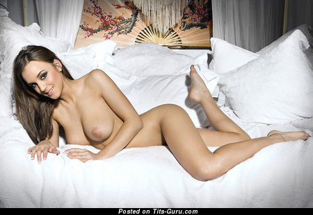 Sexy nude wonderful girl with medium tots photo
