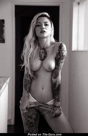 Image. Nice woman with medium natural tots photo