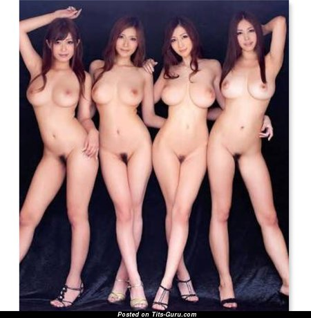 Sexy topless asian with medium natural tittes photo