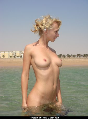 Image. Nude wonderful woman with medium natural boobies picture