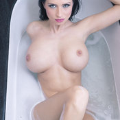 Lilly Roma - sexy wet nude brunette with medium natural boobs image