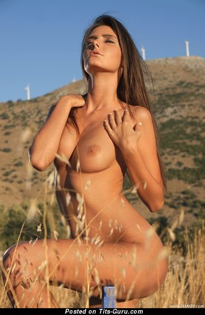 Naked brunette with medium natural breast photo